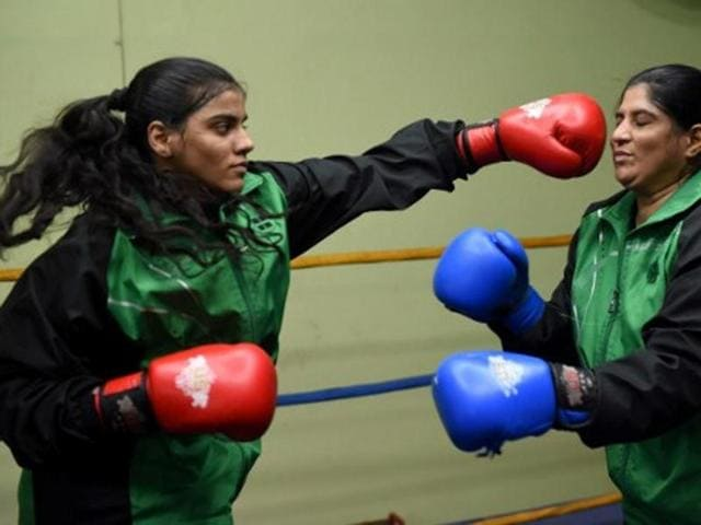 In this photograph taken on October 6, 2016, 19-year-old Pakistani boxer Razia Banu (L) throws a punch at her mother Haleema Abdul Aziz during a practice session at the Pak Shaheen Boxing Club in Karachi.
