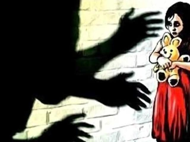 While the girl was engrossed in watching TV, the woman came from behind and caught the her hands, while her husband allegedly raped her