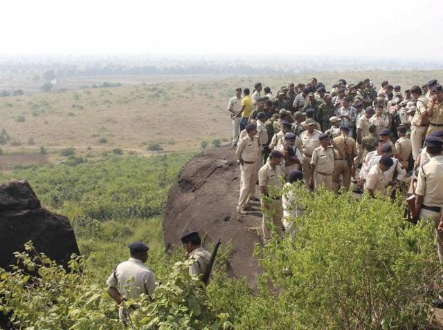 Policemen at the site where eight suspected SIMImembers were killed in an encounter in Madhya Pradesh on Monday.
