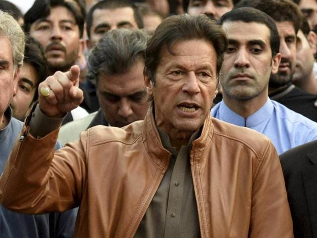 Imran Khan, Pakistan's cricketer-turned-politician addresses his supporters outsiders residence in Islamabad, Pakistan.