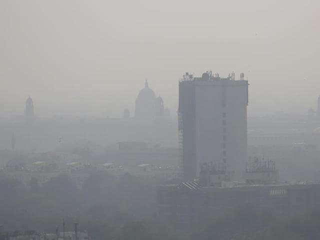 A layer of smog envelops the city skyline before Diwali festival in New Delhi.
