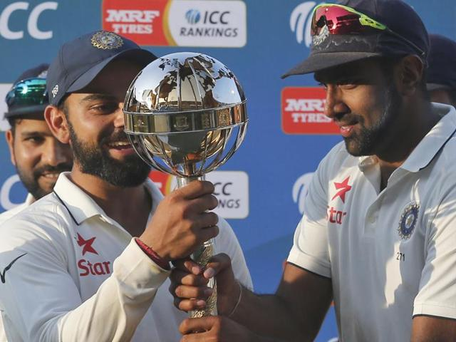 Indian cricket team captain Virat Kohli, left, and teammate Ravichandran Ashwin hold the ICC Test Championship mace.