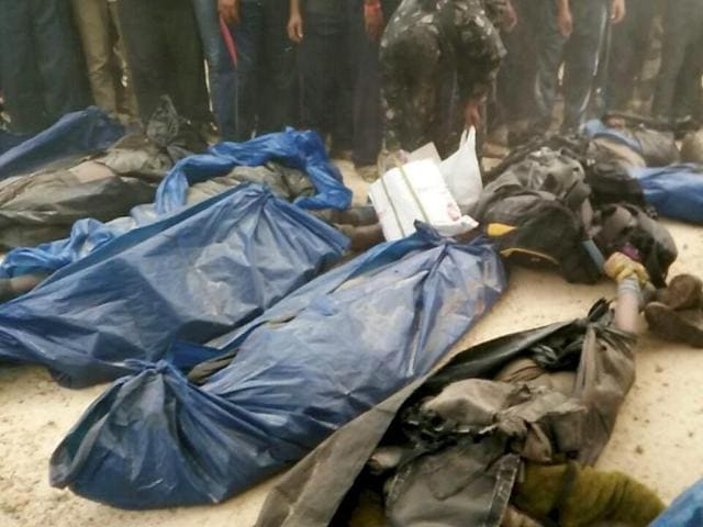 Dead bodies of 23 Maoists killed in a joint police encounter by Odisha and Andhra police at a forest in Malkangiri .