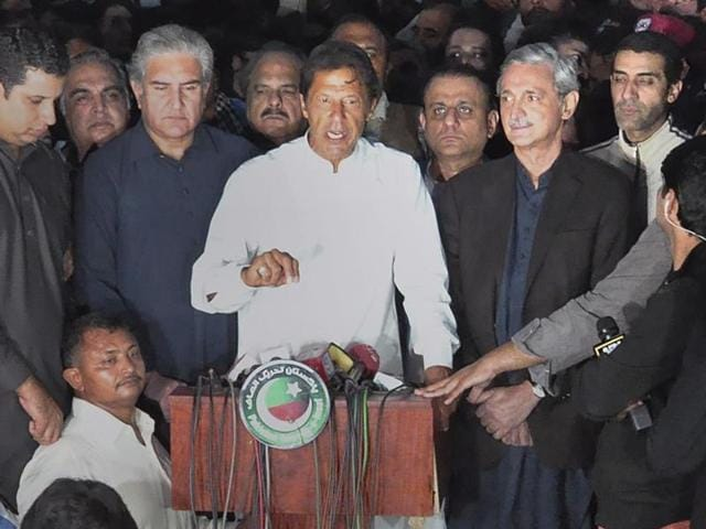 Supporters of Pakistani opposition leader Imran Khan chant anti-government slogans outside Khan's residence in Islamabad, Pakistan.