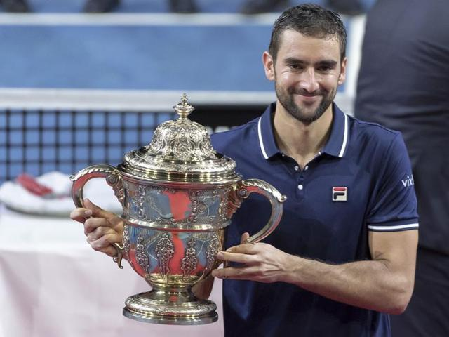 Cilic, left, and Nishikori pose with their trophies during the presentation ceremony.