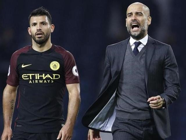 Manchester City manager Pep Guardiola gestures during the English Premier League.