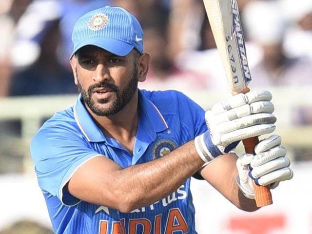 Indian captain MS Dhoni congratulates Virat Kohli on his half century.