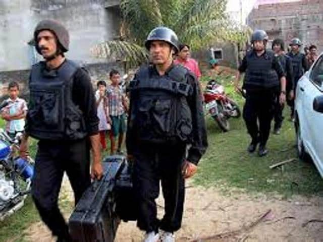Policemen lock the house where an IED exploded accidentally on October 2, 2014 revealing the biggest terror network operating in Bengal so far.