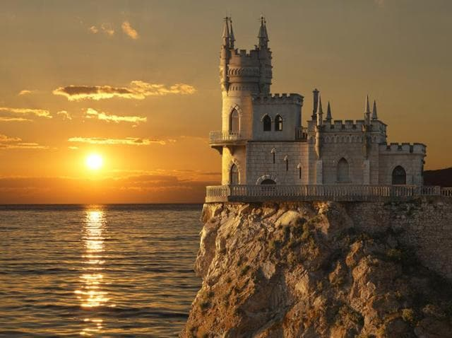 Swallow's Nest castle on the rock over the Black Sea at sunset.  It is a decorative castle located at Gaspra, a small spa town between Yalta and Alupka, in Crimea.