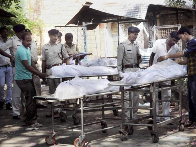 Bodies of SIMI terrorists who were killed in an encounter being handed over to their relatives and family members after post-mortem in Bhopal.(PTI Photo)