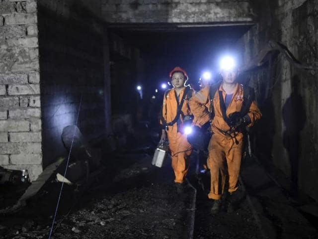 Rescuers worked through the night at the privately owned Jinshangou mine where the explosion occurred before noon Monday.