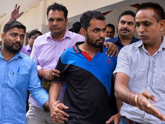 Delhi Police crime branch arrested two Rajasthan residents (centre two) for spying on October 27, 2016, after they caught a Pakistan high commission staffer carrying documents with sensitive, confidential documents.