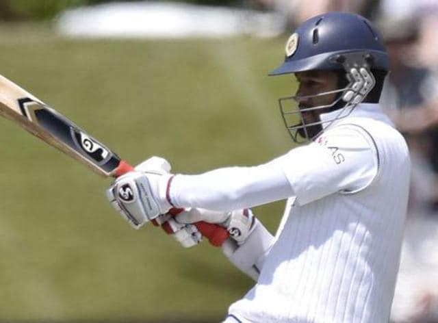 Dimuth Karunaratne was dropped on 5 and rode on his luck to notch up a century after 12 innings.