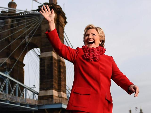 US Democratic presidential nominee Hillary Clinton waves to supporters during a campaign rally in Cincinnati, Ohio.