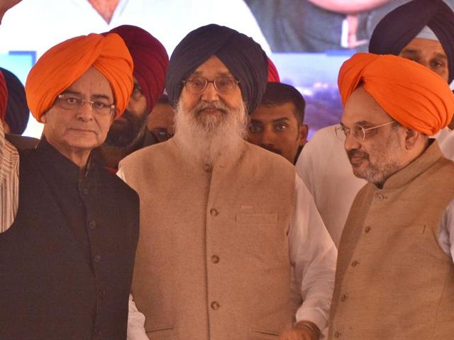 From left, Union finance minister Arun Jaitley, Punjab CM Parkash Singh Badal, and BJP president Amit Shah, at a rally to mark the 50th anniversary of the Punjabi suba (province) as formed in linguistic basis in 1966, in Amritsar on Tuesday.