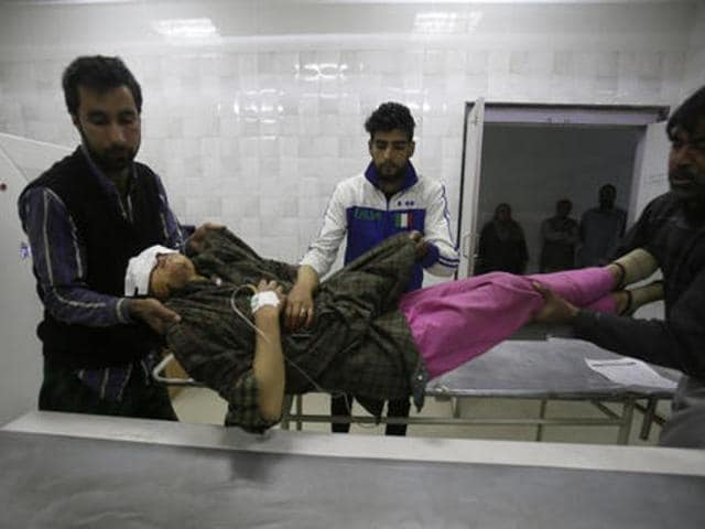 An injured Kashmiri woman is brought for treatment to a hospital in Srinagar, on October 31, 2016. Several people were injured on Monday after government forces fired pellets and tear gas during clashes between troops and stone-pelting protesters in Pulwama, southern Kashmir.(AP)