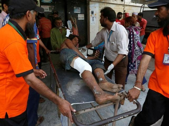 Rescue workers move a man who was injured after an explosion at the Gadani ship-breaking yard, at a hospital in Karachi, Pakistan on Tuesday.