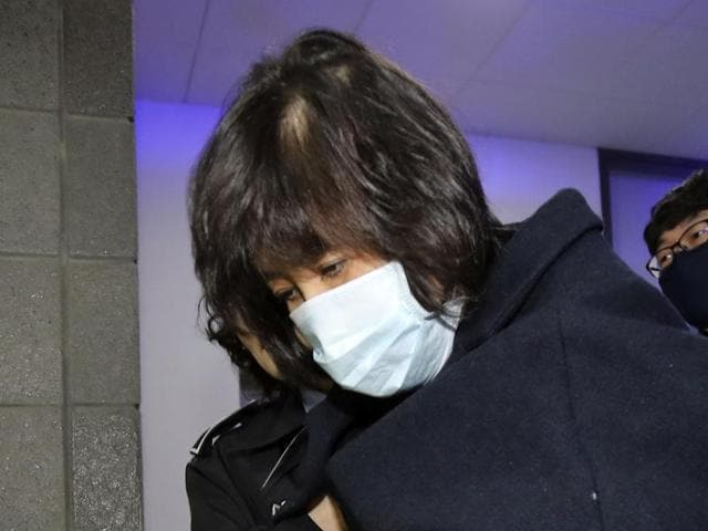 Choi Soon-sil, a woman at the center of a scandal that threatens the country's president, was detained by prosecutors on Tuesday.