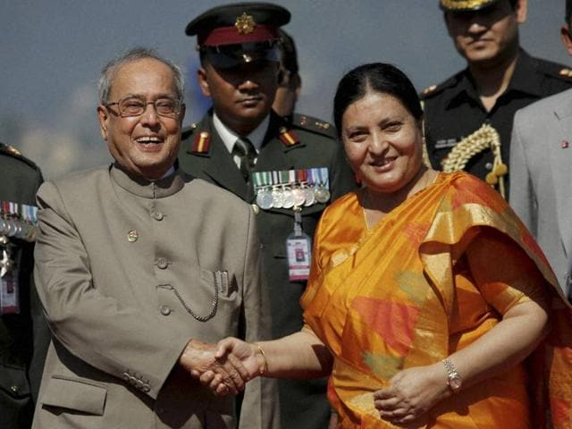 Indian President Pranab Mukherjee inspects a guard of honour upon his arrival at the Tribhuvan International Airport in Kathmandu on Wednesday.
