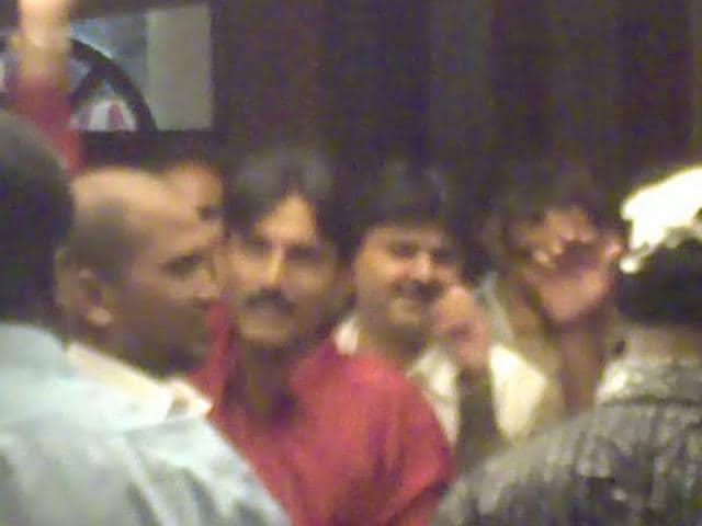A TV grab shows Chhota Rajan aides Sunil Poddar (in red shirt) and Farid Tanasha (behind Poddar) at a party in a  Chembur club.