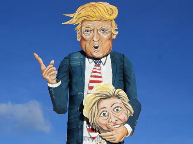 Masks depict Republican presidential candidate Donald Trump and socks depict his Democratic rival Hillary Clinton at a candy shop in Pasadena, California, on October 30, 2016. America will vote for its new POTUS on November 8, 2016.