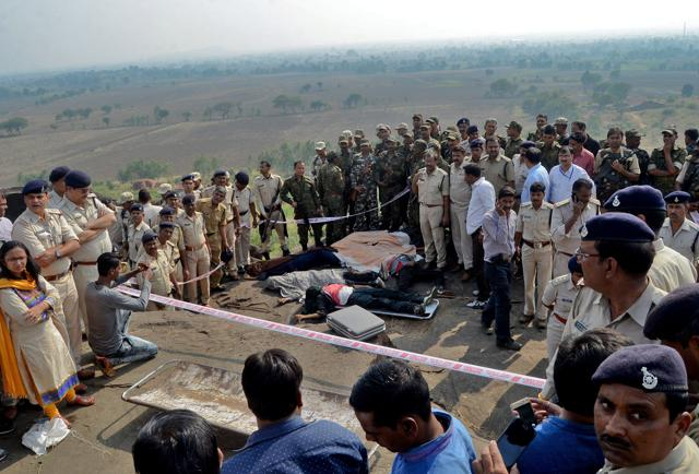 Bhopal: Police investigate the encounter site at the hillocks of Acharpura village after the STF killed 8 Students of Islamic Movement of India (SIMI) activists who escaped Central Jail killing a security guard in Bhopal on Monday.