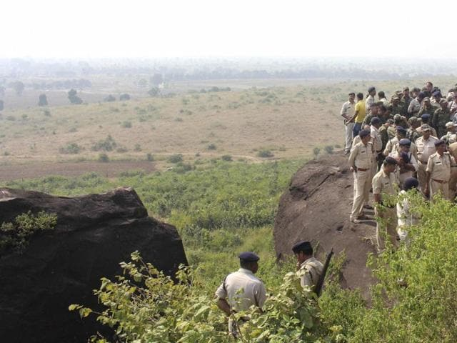 Police investigate the encounter site at the hillocks of Acharpura village after the STF killed 8 Students of Islamic Movement of India (SIMI) activists who escaped Central Jail killing a security guard in Bhopal on October 31, 2016.