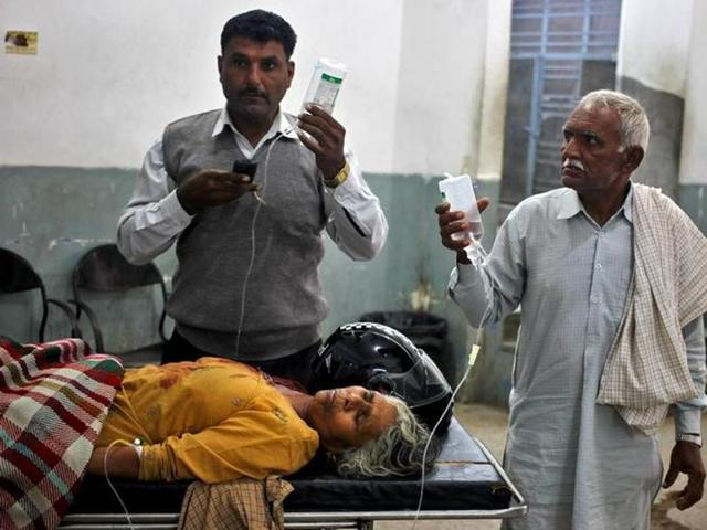 A woman who was wounded in a shelling attack at the international border with Pakistan, is pictured inside a government hospital in Jammu, November 1, 2016.