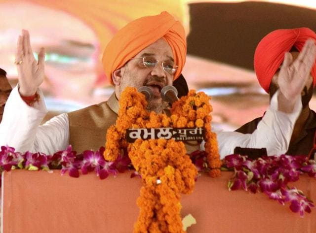 Bharatiya Janta Party (BJP) president Amit Shah (C) gestures as he addresses a function in Amritsar on November 1.