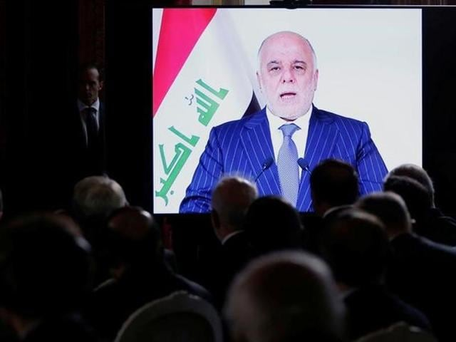 File photo Iraqi Prime Minister Haider al-Abadi, seen on a screen as he speaks via a videoconference during a ministerial summit to hold discussion on the future of Mosul city, post-Islamic State, in Paris, France. Abadi has warned Turkey against  provoking confrontation after Ankara deployed tanks near the border on November 1, 2016.