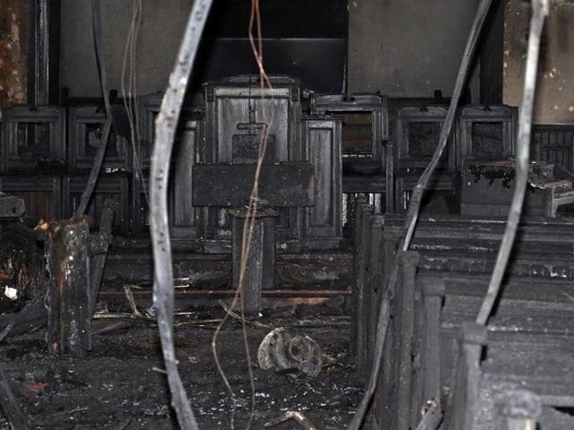 Cables hang from the ceiling in the fire damaged Hopewell M B Baptist Church in Greenville, Mississippi on Wednesday.