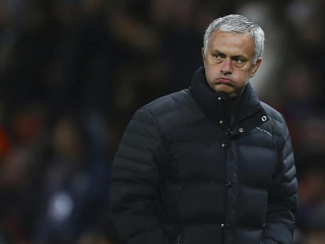 Jose Mourinho (R) gesturing and shouting in the Directors Box after being sent off to the stands during the  match between Manchester United and Burnley on Saturday at Old Trafford, Manchester.