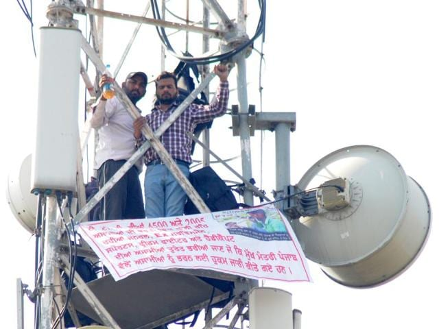Protesters seeking teaching jobs from the Punjab government on a mobile signal tower in Sector 3, Chandigarh, on Thursday.