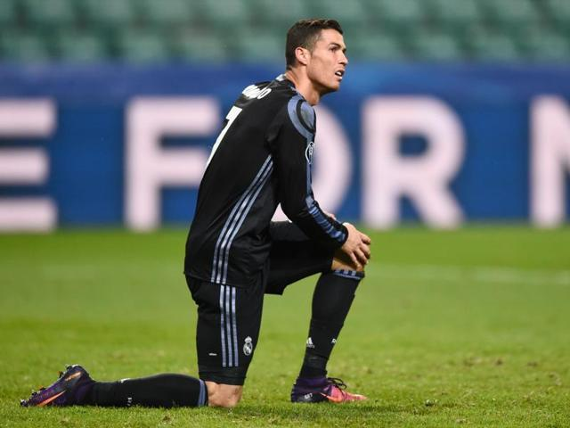 Real Madrid's Cristiano Ronaldo (L) and Gareth Bale walk off the pitch after the match.