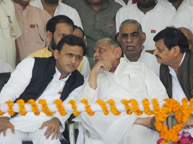 Uttar Pradesh chief minister Akhilesh Yadav with SP chief Mulayam Singh Yadav and Shivpal Yadav during 'Vikas Rath Yatra' in Lucknow.