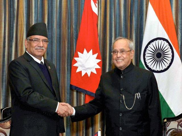 President Pranab Mukherjee with Indian Ambassador to Nepal, Ranjit Rae during a reception hosted in his honour in Kathmandu on Wednesday.(PTI)