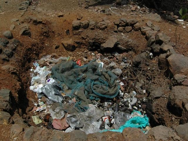 Biomedical waste disposed of in a pit.