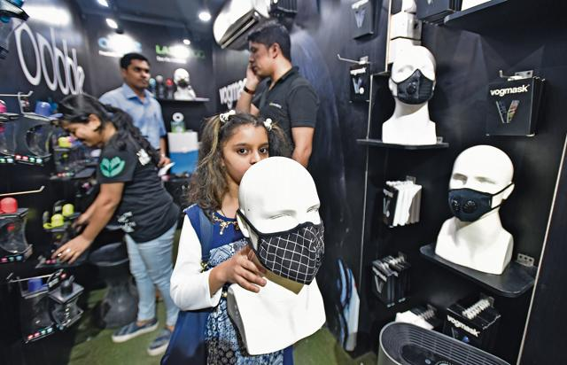 People buying air masks at Khan Market in New Delhi, India.