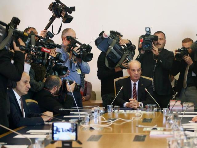 Turkey's former Chief of Staff Ilker Basburg (C) speaks to the members of a parliamentary commission investigating the failed July 2016 coup, at the parliament in Ankara on November 3, 2016.