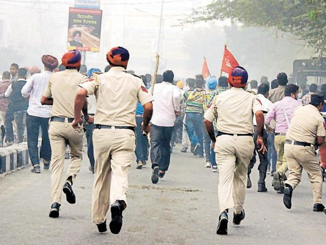 thermal plant employees,protesting employees,employees lathicharged