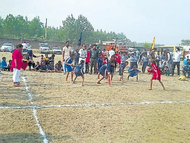 The students playing barefoot during the district primary school games near Phillaur in Jalandhar on Thursday.