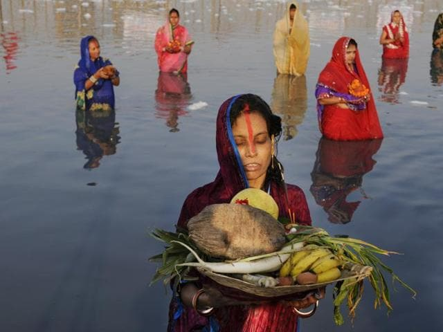 Hindus offer prayers during Chhath Puja on the banks of river Yamuna in Noida, India.