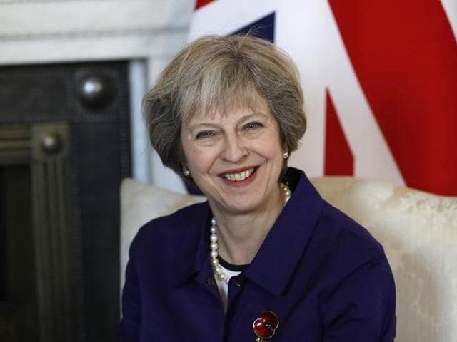 Britain's Prime Minister Theresa May smiles during a bilateral meeting with Colombia's President Juan Manuel Santos at 10 Downing Street in London.