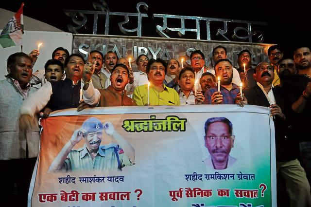 Congress leaders organise a candle march in Bhopal on Thursday to pay tribute to slain jail warder Ramshankar Yadav and Ram Kishan Grewal who killed self over OROP issue.