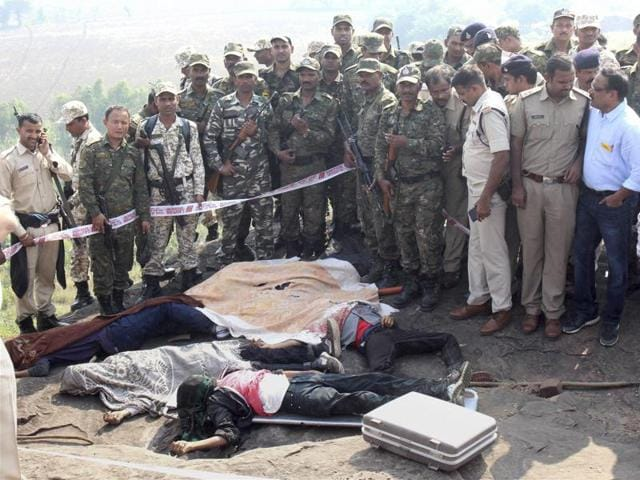 Police at the encounter site at the hillocks of Acharpura village after the STF killed 8 Students of Islamic Movement of India (SIMI) activists who escaped Central Jail killing a security guard in Bhopal on Monday.