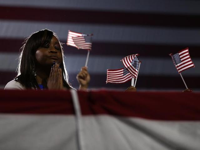 A supporter prays during a campaign rally at Coastal Credit Union Music Park at Walnut Creek on Friday in Raleigh, North Carolina.