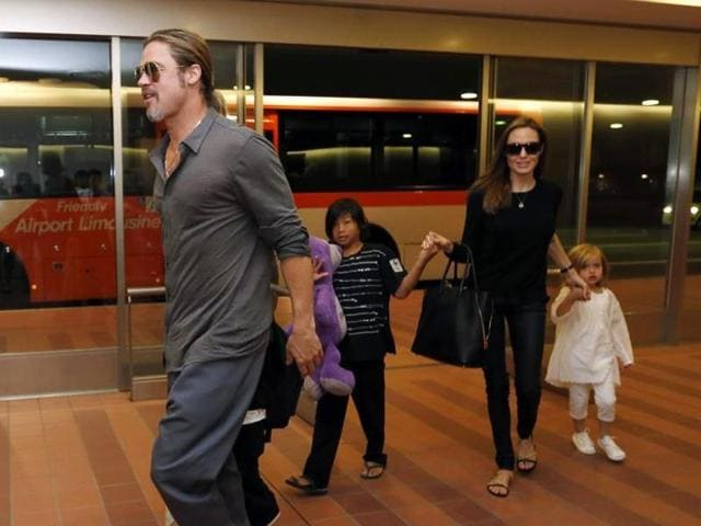 Hollywood actors Brad Pitt (L) and actress Angelina Jolie (2nd R) arrive with their children Knox (beside Pitt), Vivienne (R) and Pax (C) at Haneda international airport in Tokyo, Japan on July 28, 2013. (Reuters)