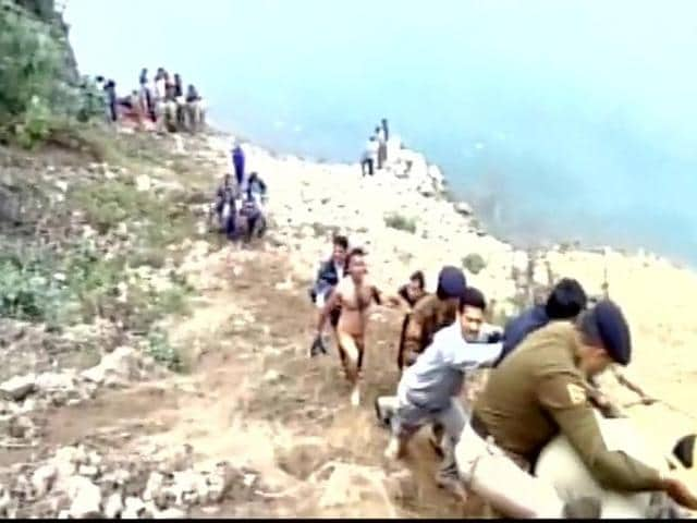 Rescue operations underway after an overloaded private bus plunged into a gorge near Mandi town in Himachal Pradesh.