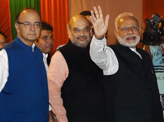 Prime Minister Narendra Modi with BJP president Amit Shah and finance minister Arun Jaitley at the party headquarters in New Delhi.