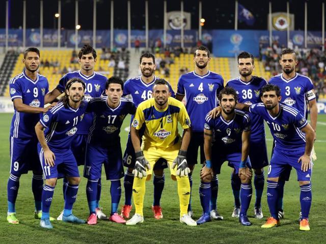 Iraq's Air Force Club team line up before their match. REUTERS/Ibrahem Alomari